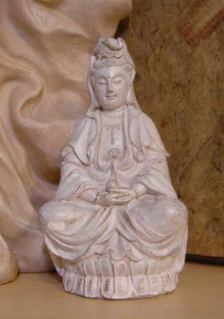 Small ivory and gold colored statue