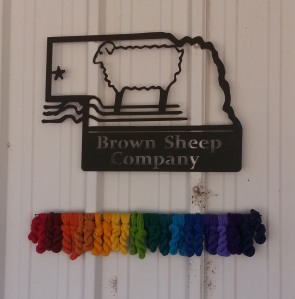 Brown Sheep Sign on Building