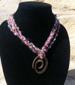 Spiral pendant on rock