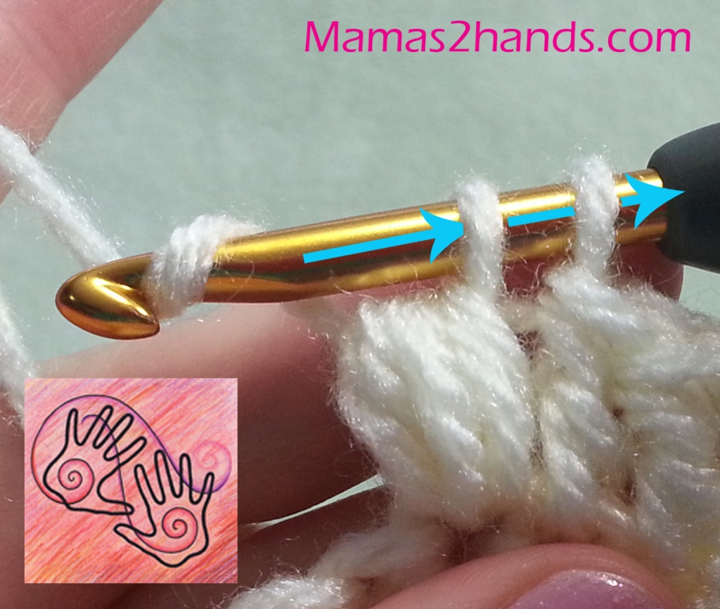 """Image shows crochet hook with 2 loops on it (one loop is coming thru all the """"puff"""" loops) and arrows showing the direction to pull a yarn-over thru the 2 loops."""